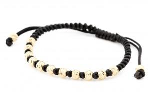 Золотой браслет с черной нитью